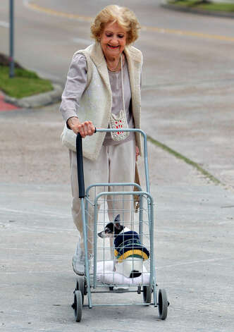 Janet Conner pushes her 16-year-old dog Penny Pabst as they walk to the store along Sawyer Street Monday, Feb. 4, 2013, in Houston. Conner walks to the store after she stopped driving two years ago. Photo: Cody Duty, Houston Chronicle / © 2013 Houston Chronicle