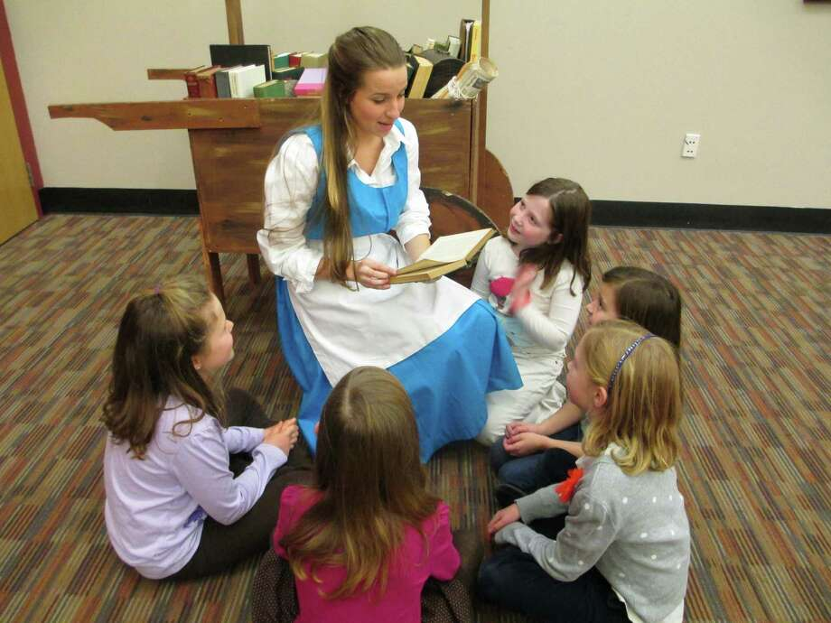 "Starting with the upcoming show ""Beauty & the Beast,"" tickets for New Canaan High School Theatre are now being sold online. Belle (played by Christy Coco) reads to local kids. Photo: Contributed"