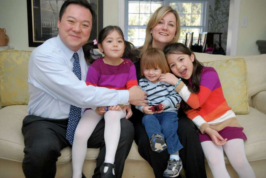 State Rep. William Tong  announces his candidacy for mayor on Monday February 4, 2013 with his family, wife Elizabeth, daughters Penelope (4), son Sasha (19 months) and Eleanor (6) at his home before he formally announcing at Sorrento Pizzeria & Restaurant on High Ridge Road in Stamford, Conn. Photo: Dru Nadler / Stamford Advocate Freelance