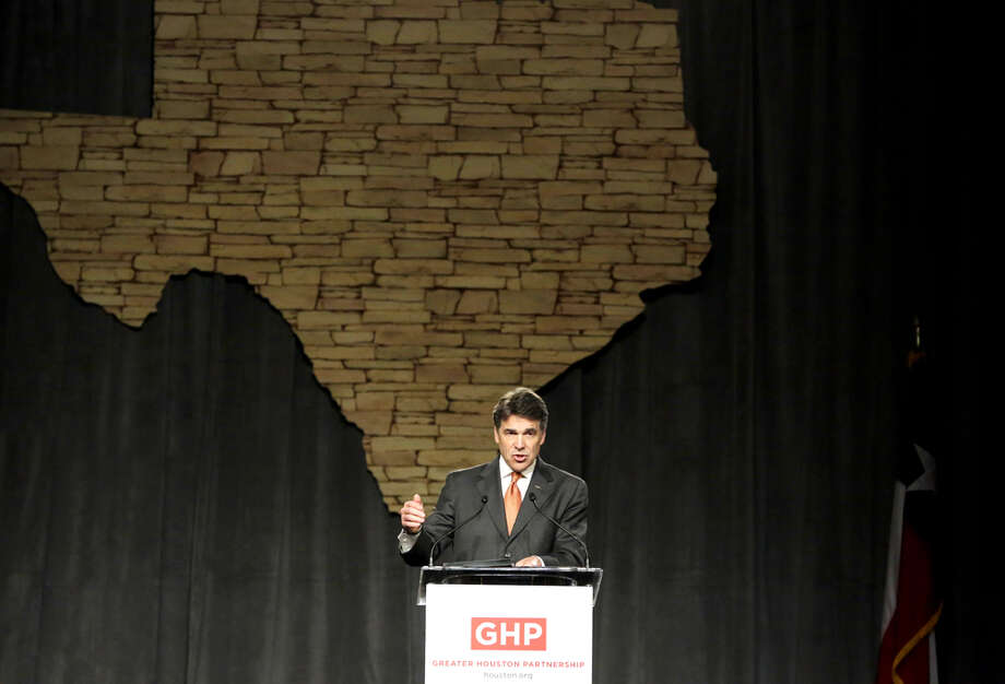 Texas Gov. Rick Perry speaks Jan. 31, 2013, during the Greater Houston Partnership luncheon at the Hilton Americas hotel in Houston. Photo: TODD SPOTH, . / Todd Spoth
