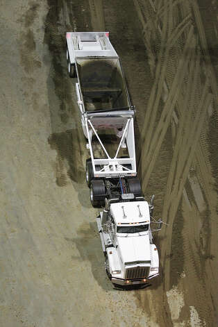 Tons of top soil are hauled into the AT&T Center, Monday,  Feb. 4, 2013, in preparations for the San Antonio Stock Show & Rodeo. The stock show and rodeo starts on Thursday, Feb. 7 and runs through Feb. 24. Photo: JERRY LARA, San Antonio Express-News / © 2013 San Antonio Express-News