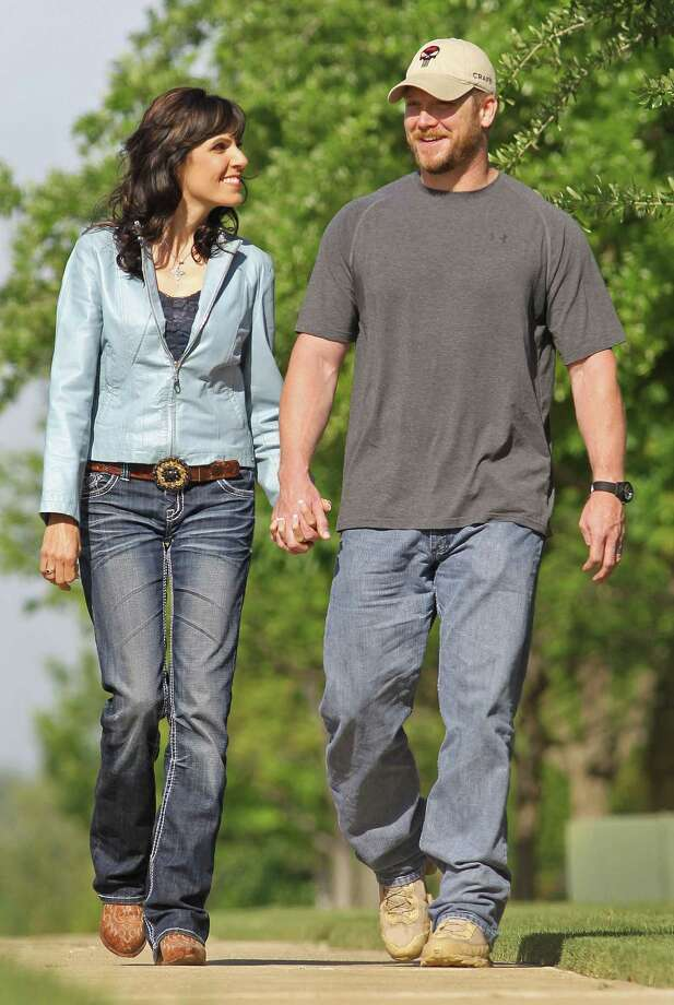 """Chris Kyle, a retired Navy SEAL and bestselling author of the book """"American Sniper: The Autobiography of the Most Lethal Sniper in U.S. Military History,"""" is seen with his wife, Taya, April 6, 2012. Kyle was one of two people reported killed on the gun range at Rough Creek Lodge near Glen Rose, Saturday, February 2, 2013. (Paul Moseley/Fort Worth Star-Telegram/MCT) Photo: Paul Moseley, McClatchy-Tribune News Service / Fort Worth Star-Telegram"""
