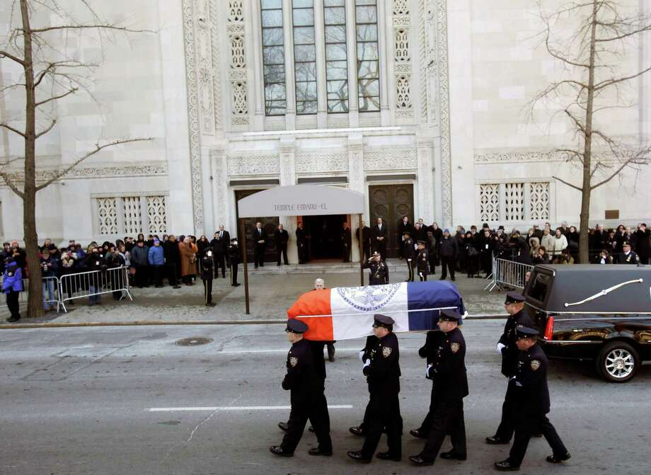 The casket containing the remains of former New York City Mayor Ed Koch is carried by police officers  into Temple Emanu-El for his funeral in New York, Monday, Feb. 4, 2013.  Koch died Friday of congestive heart failure at age 88. Photo: Seth Wenig, AP / AP