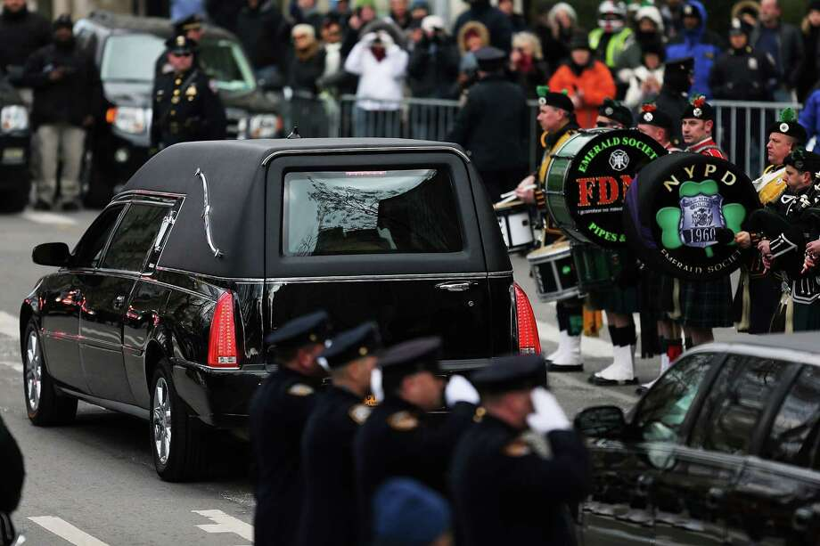 NEW YORK, NY - FEBRUARY 04:  The hearse carrying the casket of former New York City Mayor Ed Koch drives away following funeral services at Manhattan's Temple Emanu-El on February 4, 2013 in New York City.The iconic former New York mayor passed away on February 1, 2013 in New York City at age 88. Ed Koch was New York's 105th mayor and ran the city from 1978-89. He was often outspoken and combative and has been credited with rescuing the city from near-financial ruin during a three-term City Hall run. Photo: Spencer Platt, Getty Images / 2013 Getty Images