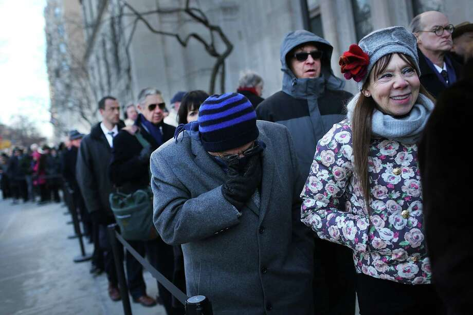 NEW YORK, NY - FEBRUARY 04:  Members of the public wait in the cold to enter funeral services for former New York City Mayor Ed Koch at Manhattan's Temple Emanu-El on February 4, 2013 in New York City.The iconic former New York mayor passed away on February 1, 2013 in New York City at age 88. Ed Koch was New York's 105th mayor and ran the city from 1978-89. He was often outspoken and combative and has been credited with rescuing the city from near-financial ruin during a three-term City Hall run. Photo: Spencer Platt, Getty Images / 2013 Getty Images