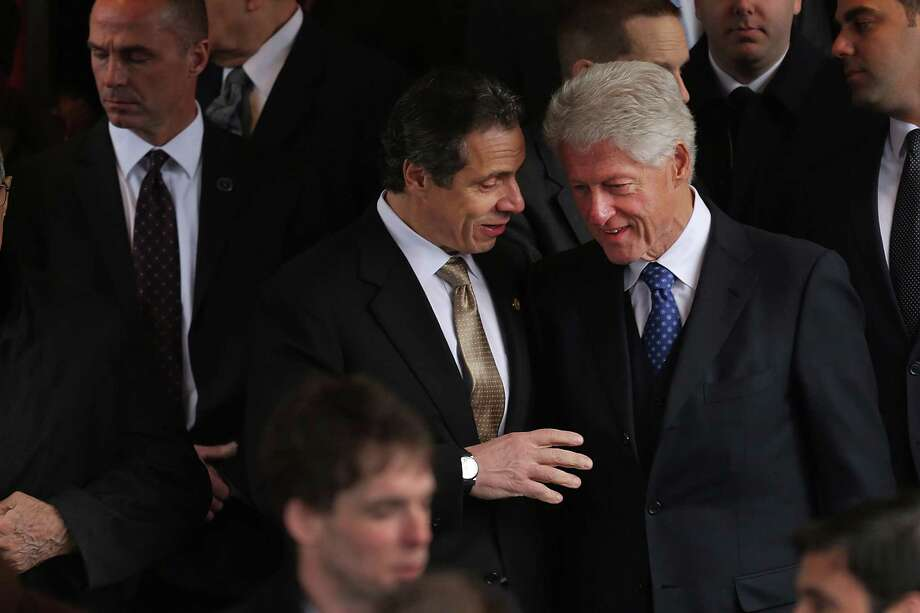 NEW YORK, NY - FEBRUARY 04:  Former President Bill Clinton (R) and New York Gov. Andrew Cuomo (C) exit funeral services for former New York Mayor Ed Koch at Manhattan's Temple Emanu-El on February 4, 2013 in New York City.The iconic former New York mayor passed away on February 1, 2013 in New York City at age 88. Ed Koch was New York's 105th mayor and ran the city from 1978-89. He was often outspoken and combative and has been credited with rescuing the city from near-financial ruin during a three-term City Hall run. Photo: Spencer Platt, Getty Images / 2013 Getty Images