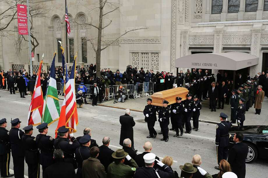 NEW YORK, NY - FEBRUARY 04:  People watch as the casket of former New York City Mayor Ed Koch is brought out by members of the New York Police Department following funeral services at Manhattan's Temple Emanu-El on February 4, 2013 in New York City.The iconic former New York mayor passed away on February 1, 2013 in New York City at age 88. Ed Koch was New York's 105th mayor and ran the city from 1978-89. He was often outspoken and combative and has been credited with rescuing the city from near-financial ruin during a three-term City Hall run. Photo: Spencer Platt, Getty Images / 2013 Getty Images