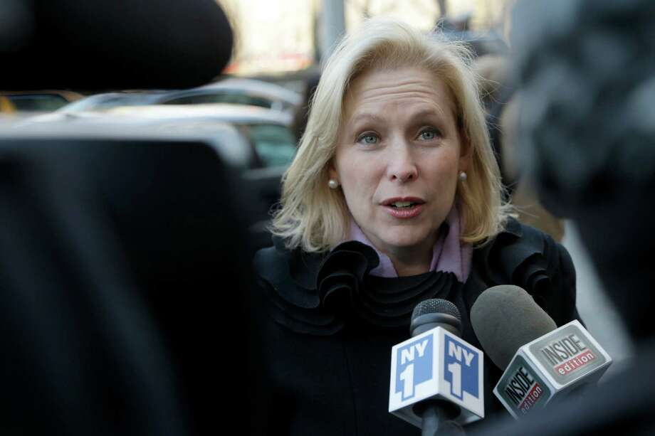 New York Senator Kirsten Gillibrand speaks to media as she arrives for the funeral of  former New York City Mayor Ed Koch in New York, Monday, Feb. 4, 2013. Koch was remembered as the quintessential New Yorker during a funeral that frequently elicited laughter, recalling his famous one-liners and amusing antics in the public eye. Koch died Friday of congestive heart failure at age 88. Photo: Seth Wenig, AP / AP