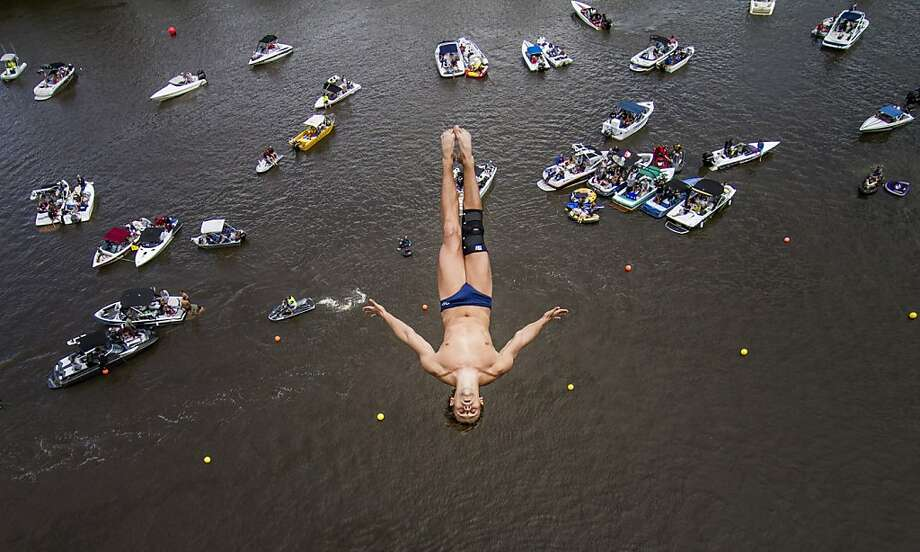 This handout photo received from Red Bull and taken on February 2, 2013 shows Anatoliy Shabotenko of the Ukraine diving from the 26 metre platform on the Hawkesbury River during the Qualification Competition for the 2013 Red Bull Cliff Diving World Series in Cattai, Sydney.  From a field of 13 divers, the top five from February 2 competition, Jonathan Paredes of Mexico, Michal Navratil of the Czech Republic, Anatoliy Shabotenko of the Ukraine, and Matt Cowen and Blake Aldridge of the UK, now join the five that have pre-qualified from last year for this season's series, which begins in May.  Photo: Romina Amato, AFP/Getty Images