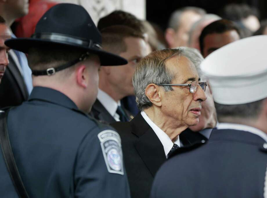 Former Governor of New York Mario Cuomo leaves the synagogue after the funeral of former New York City Mayor Ed Koch in New York, Monday, Feb. 4, 2013. Koch was remembered as the quintessential New Yorker during a funeral that frequently elicited laughter, recalling his famous one-liners and amusing antics in the public eye. Koch died Friday of congestive heart failure at age 88. Photo: Seth Wenig, AP / AP