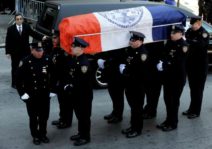 A casket containing the remains of former New York City Mayor Ed Koch is brought into Temple Emanu-E