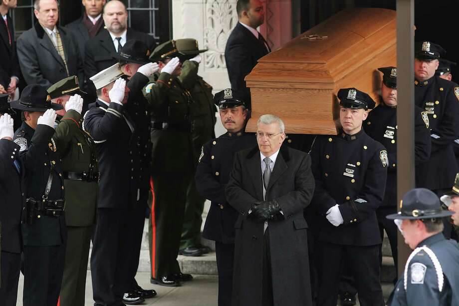 NEW YORK, NY - FEBRUARY 04: The casket of former New York City Mayor Ed Koch is brought out by members of the New York Police Department following funeral services at Manhattan's Temple Emanu-El on February 4, 2013 in New York City.The iconic former New York mayor passed away on February 1, 2013 in New York City at age 88. Ed Koch was New York's 105th mayor and ran the city from 1978-89. He was often outspoken and combative and has been credited with rescuing the city from near-financial ruin during a three-term City Hall run. Photo: Spencer Platt, Getty Images / 2013 Getty Images