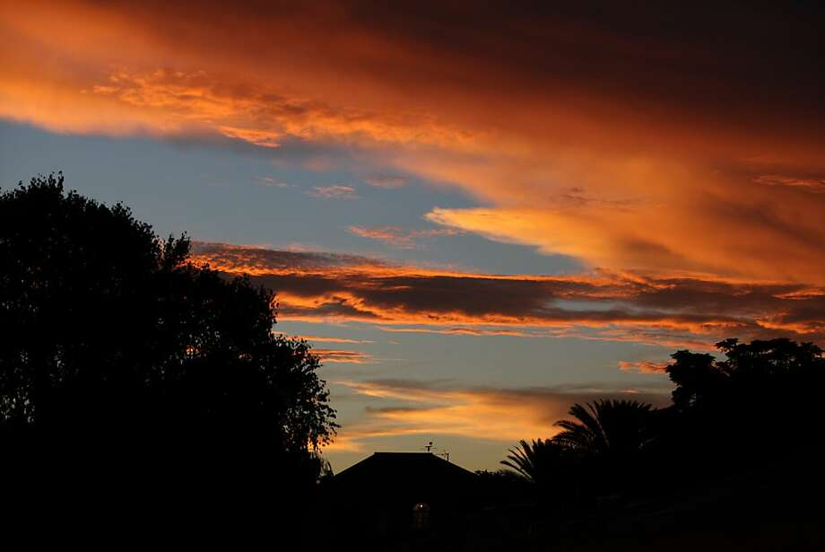 Painted sky: The sun sets after a heavy rain in Johannesburg, South Africa. Photo: Jon Gambrell, Associated Press