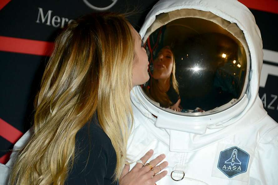 Away team to bridge - I'm being probed: Supermodel Candice Swanepoel kisses an AXE astronaut