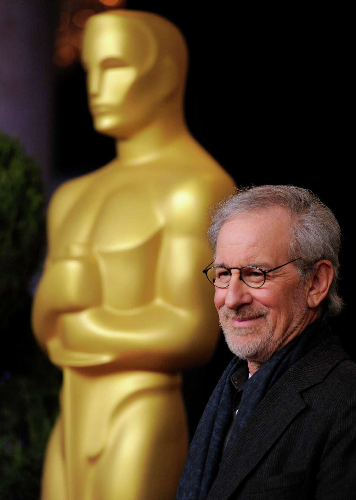 """Steven Spielberg, nominated for directing and best picture for """"Lincoln,"""" arrives at the 85th Academy Awards Nominees Luncheon at the Beverly Hilton Hotel on Monday, Feb. 4, 2013, in Beverly Hills, Calif. (Photo by Chris Pizzello/Invision/AP)"""