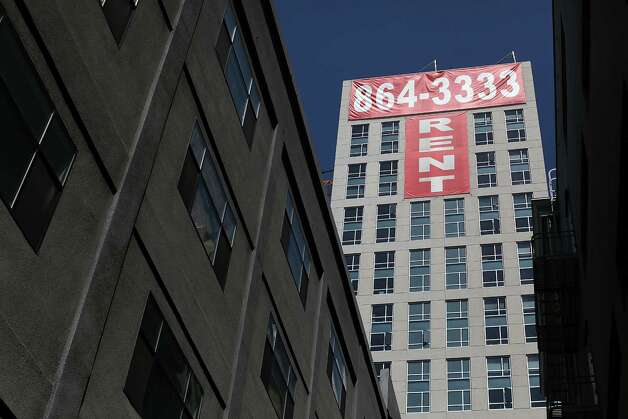 "A large ""rent"" banner is posted on the side of an apartment building on June 15, 2012 in San Francisco, California. Photo: Justin Sullivan, Getty Images / 2012 Getty Images"