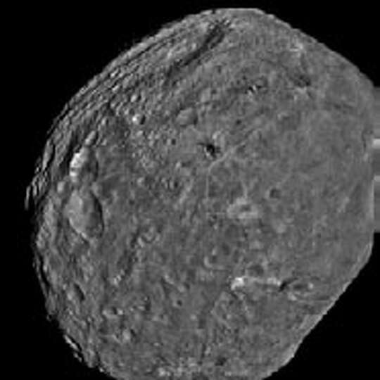 Dawn mission data has revealed the rugged topography and complex textures of the asteroid Vesta�s