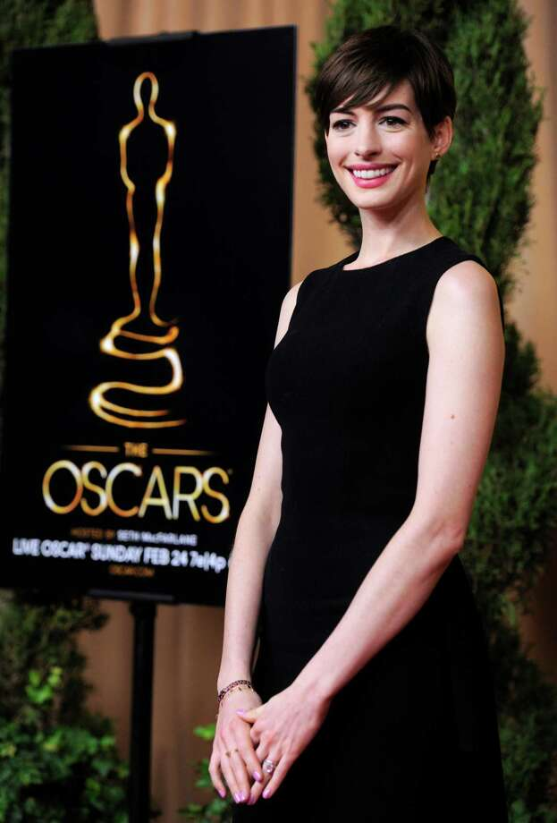 "Anne Hathaway, nominated for best actress in a supporting role for ""Les Miserables,"" arrives at the 85th Academy Awards Nominees Luncheon at the Beverly Hilton Hotel on Monday, Feb. 4, 2013, in Beverly Hills, Calif. (Photo by Chris Pizzello/Invision/AP) Photo: Chris Pizzello"