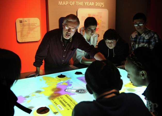 Education coordinator Jim Sirch uses an interactive map with students from New Haven's Ross Woodward Classical Studies magnet school to teach about carbon dioxide emissions in the new global warming exhibit at the Peabody Museum in New Haven on Wednesday, January 30, 2013. Photo: Brian A. Pounds