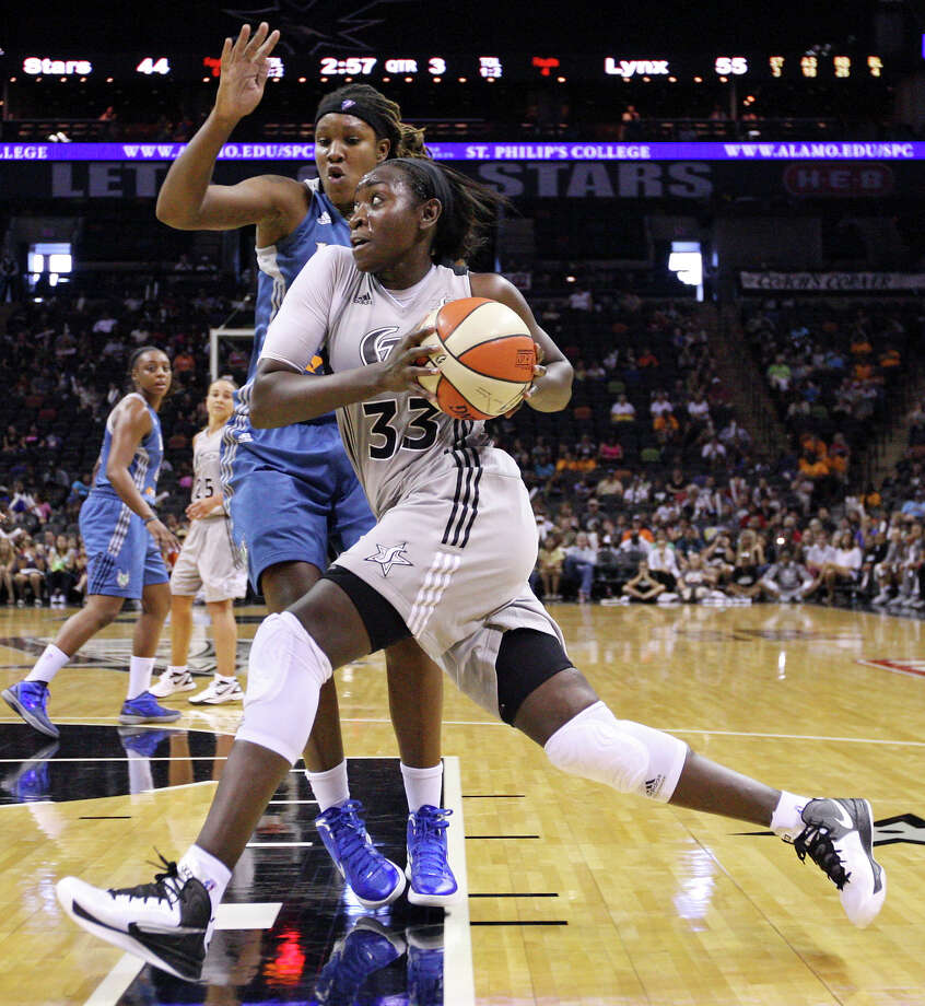 Silver Stars' Sophia Young looks for room around Lynx's Rebekkah Brunson during second half action Sunday Sept. 9, 2012 at the AT&T Center.  The Lynx won 81-62. Photo: Edward A. Ornelas, Express-News / © 2012 San Antonio Express-News