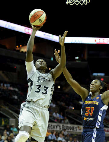 San Antonio Silver Stars' Sophia Young (33) takes a shot during a WNBA game between the San Antonio Silver Stars and the Connecticut Sun on August 30, 2012 at the AT&T Center in San Antonio Texas.