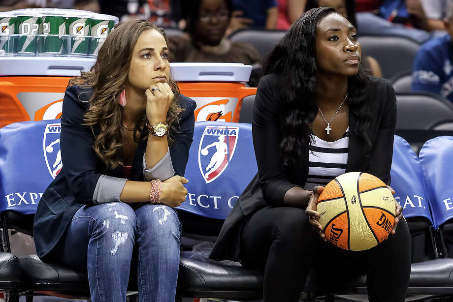 Silver Stars' Becky Hammon (left) and Sophia Young watch from the bench prior to their seaon finale against the Minnesota Lynx at the AT&T Center on Sept. 23, 2012. Both starters sat out the game as the Silver Stars came away with a 99-84 victory in their season finale. MARVIN PFEIFFER/ mpfeiffer@express-news.net MARVIN Photo: MARVIN PFEIFFER, Express-News / Express-News 2012
