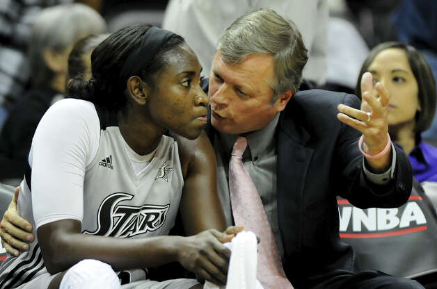 San Antonio Silver Stars' head coach Dan Hughes (right) talks with Sophia Young on the bench during a WNBA game between the San Antonio Silver Stars and the New york Liberty on September 18, 2012 at the AT&T Center in San Antonio Texas.