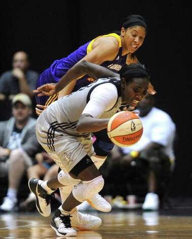 Sophia Young of the San Antonio Silver Stars beats Candace Parker of the Los Angeles Sparks to a loose ball during WNBA playoffs action at Freeman Coliseum on Saturday, Sept. 29, 2012. Photo: Billy Calzada, Express-News / © San Antonio Express-News