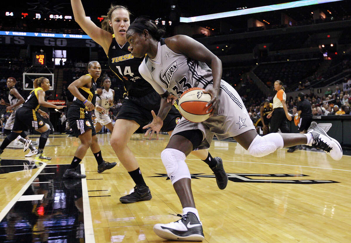 Silver Stars' Sophia Young drives around Shock's Kayla Pedersen during second half action Sunday Sept. 16, 2012 at the AT&T Center. The Shock won 80-70.