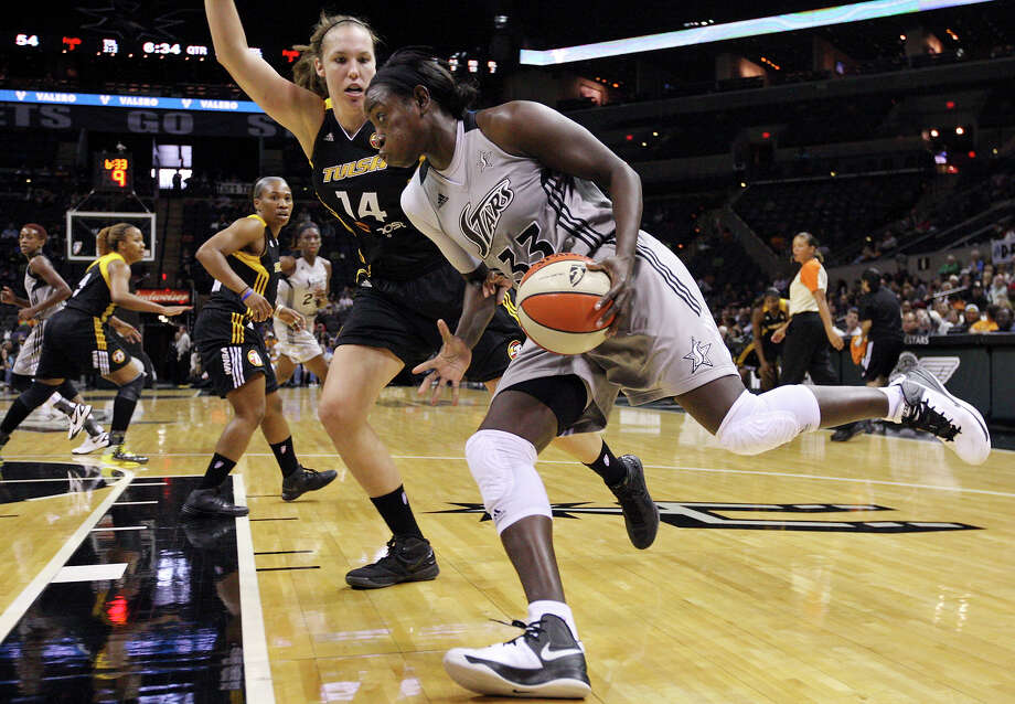 Silver Stars' Sophia Young drives around Shock's Kayla Pedersen during second half action Sunday Sept. 16, 2012 at the AT&T Center. The Shock won 80-70. Photo: Edward A. Ornelas, Express-News / © 2012 San Antonio Express-News