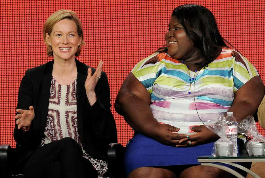"""Laura Linney, left, a cast member in the television series """"The Big C: hereafter,"""" answers a question as fellow cast member Gabourey Sidibe looks on at the Showtime Winter TCA Tour at the Langham Huntington Hotel on Saturday, Jan. 12, 2013, in Pasadena, Calif. (Photo by Chris Pizzello/Invision/AP) Photo: Chris Pizzello, INVL / Invision"""