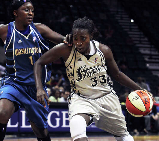 Stars forward Sophia Young is pressured byCrystal Langhorne on a drive to the basket in the second half as the San Antonio Silver Stars play the Washington Mystics at the AT&T Center in San Antonio on August 17, 2010. Tom Reel/Staff Photo: TOM REEL, Express-News / © 2010 San Antonio Express-News