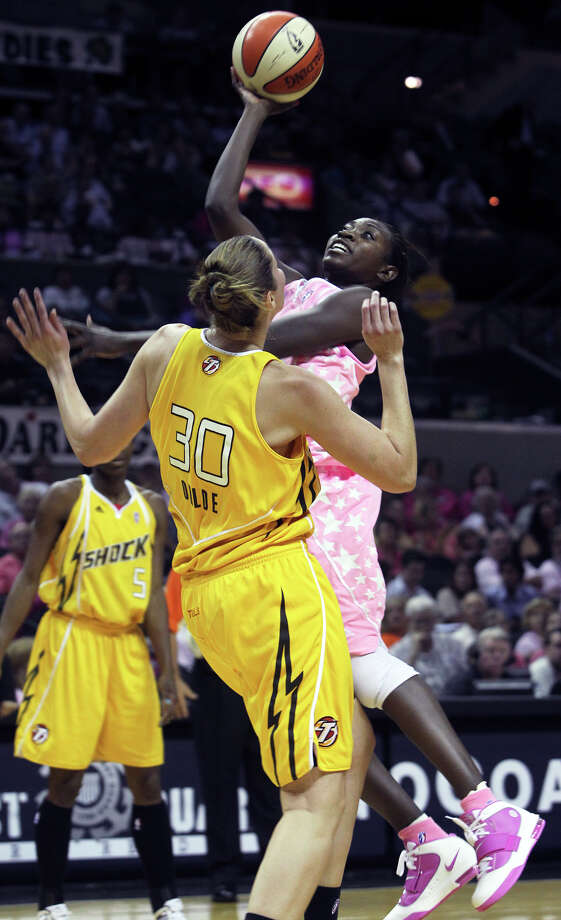 Stars forward Sophia Young gets off a jumper over Nicole Ohlde as the San Antonio Silver Stars play the Tulsa Shock at the AT&T Center in San Antonio on Friday, August 13, 2010. Tom Reel/Staff Photo: TOM REEL, Express-News / © 2010 San Antonio Express-News