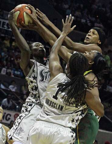 San Antonio Silver Stars forward Sophia Young (33), goes for the rebound against Seattle Storm guard Tanisha Wright at the AT&T Center on July 20, 2010. The Silver Stars lost 74 to 80. PHOTO BY SARA M. STRICK/sstrick@express-news.net Photo: SARA M. STRICK, Express-News / sstrick@express-news.net
