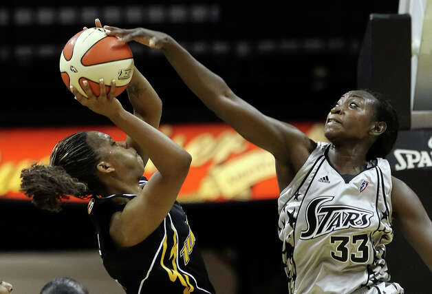 Silver Stars' Sophia Young (33) blocks a shot by Tulsa Shock's Amber Holt in the second half at the AT&T Center on Friday, June 11, 2010. Silver Stars win 87-75. Kin Man Hui/kmhui@express-news.net Photo: KIN MAN HUI, Express-News / San Antonio Express-News