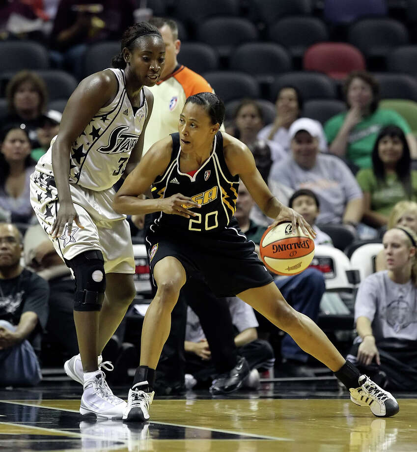 Silver Stars' Sophia Young (33) defends against Tulsa Shock's Marion Jones (20) in the first half at the AT&T Center on Friday, June 11, 2010. Kin Man Hui/kmhui@express-news.net Photo: KIN MAN HUI, Express-News / San Antonio Express-News