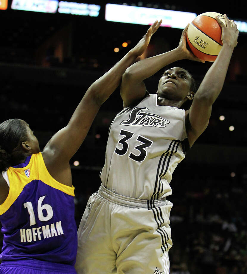 Silver Stars' Sophia Young (33) attempts a shot against Los Angeles Sparks' Ebony Hoffman (16) in the second half at the AT&T Center on Tuesday, July 12, 2011. Sparks defeat the Silver Stars, 84-74. Kin Man Hui/kmhui@express-news.net Photo: KIN MAN HUI, Express-News / San Antonio Express-News