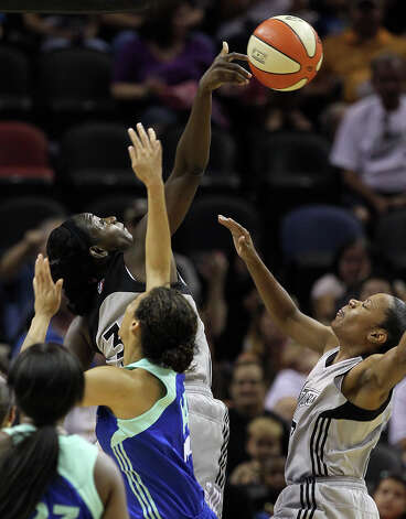 Silver Stars' Sophia Young blocks a shot by New York Liberty's Nicole Powell (14) in the first half at the AT&T Center on Friday, July 8, 2011. Kin Man Hui/kmhui@express-news.net Photo: KIN MAN HUI, Express-News / San Antonio Express-News