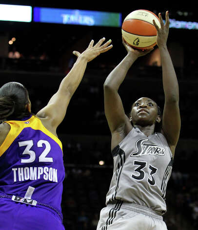 Silver Stars' Sophia Young (33) shoots over Los Angeles Sparks' Tina Thompson (32) at the AT&T Center on Friday, June 24, 2011. Silver Stars defeated the Sparks, 90-80, in overtime. Kin Man Hui/kmhui@express-news.net Photo: KIN MAN HUI, Express-News / San Antonio Express-News