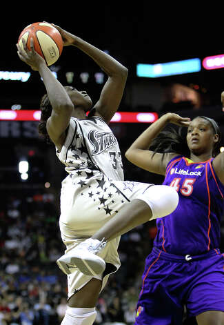 Silver Stars' Sophia Young (33) puts up a shot against Phoenix Mercury's Kara Braxton (45) in Game 2 of the Western Conference semifinals at the AT&T Center on Saturday, August 28, 2010. Kin Man Hui/kmhui@express-news.net Photo: KIN MAN HUI, Express-News / San Antonio Express-News