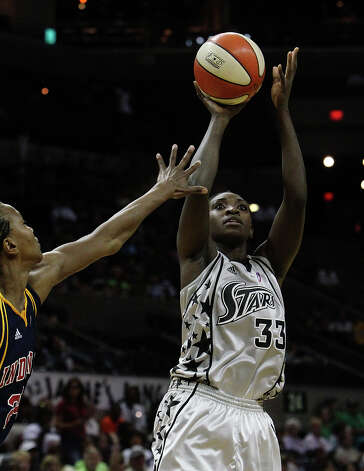 Silver Stars' Sophia Young (right) shoots against the Indiana Fever's Tamika Catchings (24) in the second half at the AT&T Center on Friday, August 20, 2010. Stars defeated the Fever, 75-61. Kin Man Hui/kmhui@express-news.net Photo: KIN MAN HUI, Express-News / San Antonio Express-News