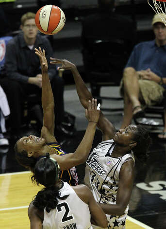 Silver Stars' Sophia Young (33) commits a foul against Indiana Fever's Tamika Catchings (24) in the first half at the AT&T Center on Friday, August 20, 2010. Kin Man Hui/kmhui@express-news.net Photo: KIN MAN HUI, Express-News / San Antonio Express-News