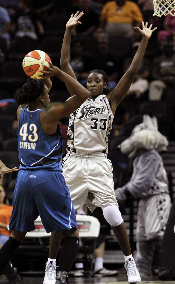 Stars forward Sophia Young plays defense against Nakia Sanford as the San Antonio Silver Stars play the Washington Mystics at the AT&T Center in San Antonio on August 17, 2010. Tom Reel/Staff Photo: TOM REEL, Express-News / © 2010 San Antonio Express-News