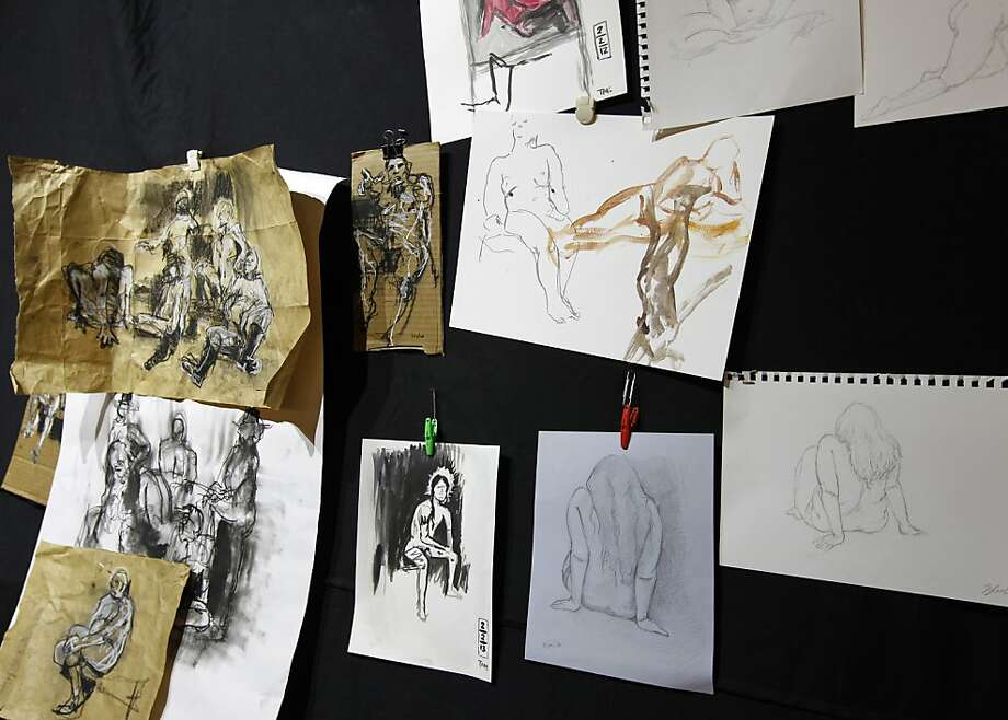 Artists turned out sketches and paintings, left, of a dozen nude models, below. Photo: Paul Chinn, The Chronicle