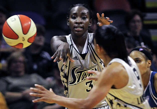 SPORTS Stars forward Sophia Young gets an outlet pass to Edwige Lawson-Wade to start a fast break as the San Antonio Silver Stars play the Washington Mystics at the AT&T Center in San Antonio on August 17, 2010. Tom Reel/Staff Photo: TOM REEL, Express-News / © 2010 San Antonio Express-News