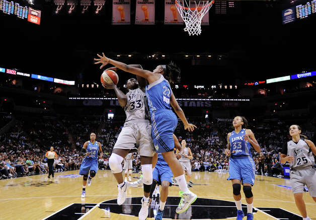 San Antonio Silver Stars' Sophia Young shoots against Minnesota Lynx's Monica Wright during second half action of Game 2 in the Western Conference semifinal Sunday Sept. 18, 2011 at the AT&T Center. The Silver Stars won 84-75. Photo: EDWARD A. ORNELAS, Express-News / SAN ANTONIO EXPRESS-NEWS (NFS)