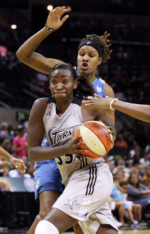 San Antonio Silver Stars' Sophia Young looks for room around Minnesota Lynx's Rebekkah Brunson during second half action of Game 2 in the Western Conference semifinal Sunday Sept. 18, 2011 at the AT&T Center. The Silver Stars won 84-75. Photo: EDWARD A. ORNELAS, Express-News / SAN ANTONIO EXPRESS-NEWS (NFS)