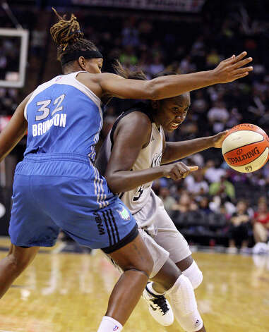 San Antonio Silver Stars' Sophia Young looks for room around Minnesota Lynx's Rebekkah Brunson during second half action Sunday Aug. 28, 2011 at the AT&T Center. The Lynx won 72-61. Photo: EDWARD A. ORNELAS, Express-News / SAN ANTONIO EXPRESS-NEWS (NFS)
