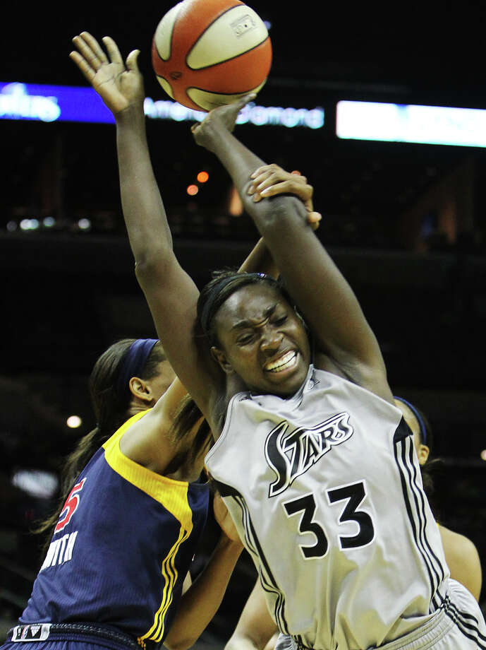 San Antonio SilverStars' Sophia Young (33) gets fouled by Indiana Fevers' Tangela Smith (05) in the second half at the AT&T Center in San Antonio on Tuesday, August 16, 2011. Silverstars lose to the Fever, 63-65. Kin Man Hui/kmhui@express-news.net Photo: KIN MAN HUI, Express-News / San Antonio Express-News