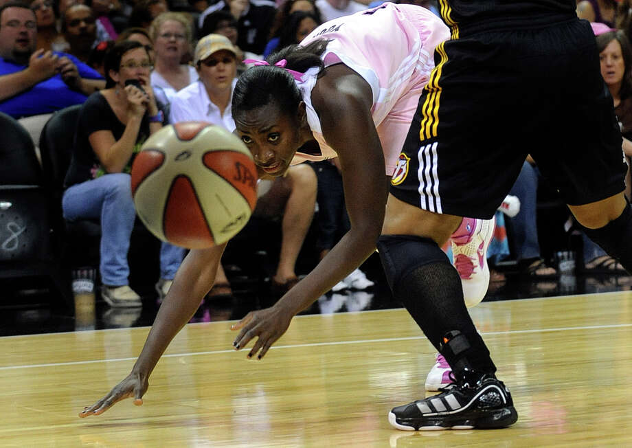 Sophia Young of the San Antonio Silver Stars chases a loose ball during WNBA action against Tulsa at the AT&T Center on Saturday, Aug. 6, 2011. BILLY CALZADA / gcalzada@express-news.net